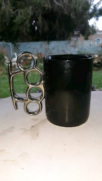 brass knuckles coffee cup  Canton