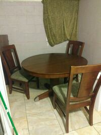 round brown wooden table with four chairs dining set Desert Hot Springs, 92240