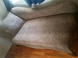brown and black leopard print chaise lounge