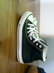 pair of black-and-white Converse high tops