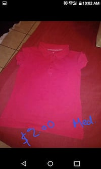 red and blue Under Armour shirt Laredo, 78046