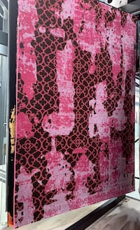 Pink and black Turkish area rug