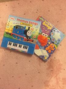 Thomas & Friends - play and learn book and Sesame Street - play a song book