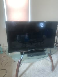 40 Inch Flat Screen Tv, DVD PLAYER and Tv Stand