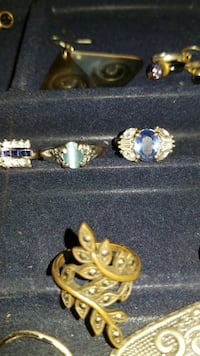 three gold-colored with variety of gemstone rings Tulsa, 74135