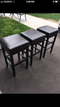 Three brown wooden bar stools Oakville, L6L 0L4