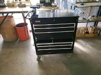 black and gray tool cabinet