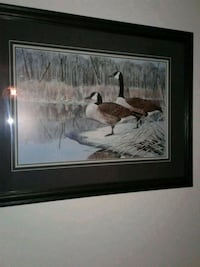 two brown ducks near river painting