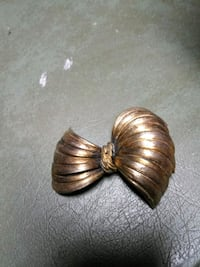 Bow gold pins by Cora Birmingham, 35212