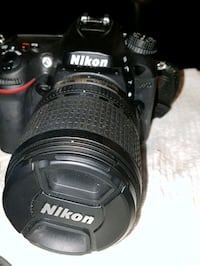 black Nikon DSLR camera with lens Calgary, T2E