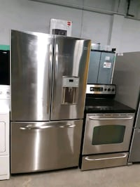 GE STAINLESS STEEL FRENCH DOORS FRIDGE AND ELECTRIC STOVE WORKING PERF Baltimore, 21223
