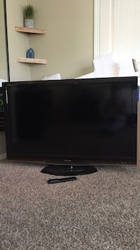 black Sharp flat screen TV with remote controller San Marcos, 78666