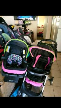 baby's black and pink travel system Las Vegas, 89110