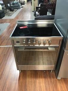 stainless steel and black induction range oven