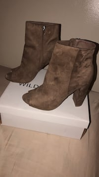 pair of brown suede heeled booties