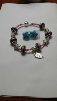 blue beaded bracelet and pair of blue star earring