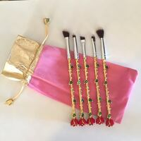 five gold-colored makeup brush set