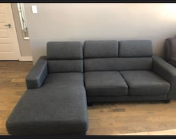 Grey sectional sofa with adjustable headrests