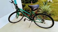 Large padded seat mountain bike with many speeds a