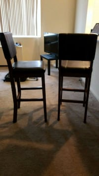 two brown wooden bar stools 26 mi