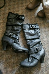 pair of black leather 2-buckle chunky heel riding  Burnaby, V3N 3B8