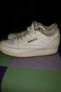 pair of white adidas low-top sneakers Winter Haven, 33880