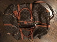 canvas monogram Louis Vuitton leather duffel bag
