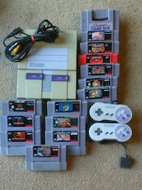assorted Nintendo game cartridges and game controllers Amherst, 24521