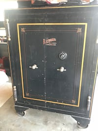 Antiqe safe. This is a very cool old (1800s) vintage safe. The kind you would have found in a Wells Fargo bank. It work perfectly I have the combo. the pinstripes and logo are original. It's missing one of the balls on the bottom hinge. It's on casters. S Orange, 92867