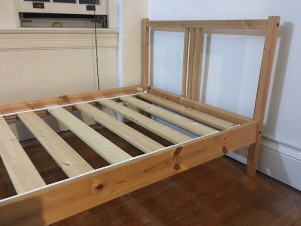 Brown and white wooden bed frame