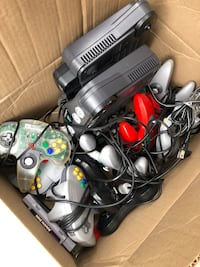 black Nintendo 64 console with controllers Germantown, 20876
