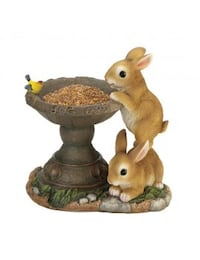Bird feed with two bunnies