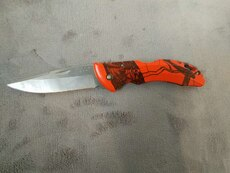 orange and silver buck knife