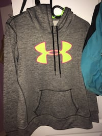 gray and green Under Armour pullover hoodie