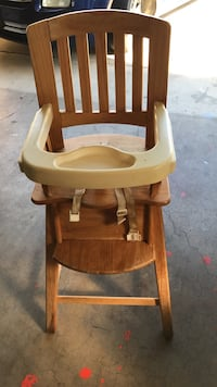 baby's brown wooden high chair