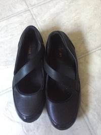 pair of black leather mary jane shoes