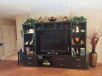 flat screen television with black wooden TV hutch Miami Shores, 33138