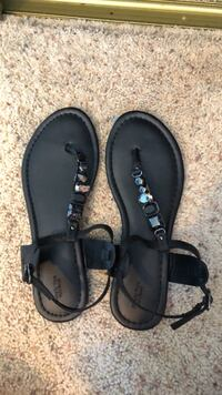 pair of black leather sandals Farmington, 55024