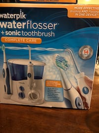 Waterpik Waterflosser with Rechargeable Toothbrush.  New in Box.  Sells for $120 in stores. Newmarket, L3X 1N7