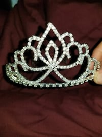 silver-colored tiara with studded diamonds