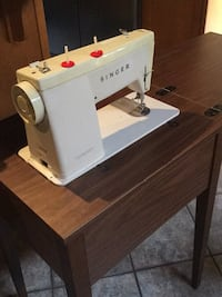 Genie Singer sewing machine and fold up holding table Ladner, V4K 4T4
