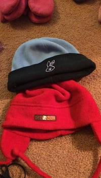 Red baby hat and purple/black hat. The two for 2.00.