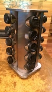 Stainless spice rack with glass spicebottles and spices  Argillite, 41144