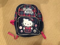 black and red Hello Kitty backpack 7 mi