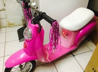 Pink and white motor scooter Fort Meade