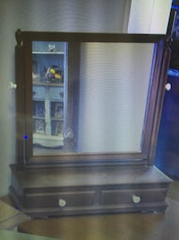 """Antique Gentlemen's Shaving Mirror in good condition. Mirror contains two large drawers with swivel mirror sized 15""""h x 17""""w and overall Shaving Mirror measuring 23""""w x 7 1/2""""d x 24""""h. $150.00 Robertsdale, 36567"""