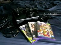 black Xbox 360 game console with game cases Marietta, 30062
