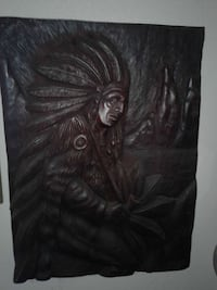 brown wooden Native American wall decor