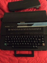 Black sharp portable electronic intelliwriter