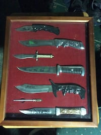 Assorted knife in glass box setting  Los Angeles, 90003